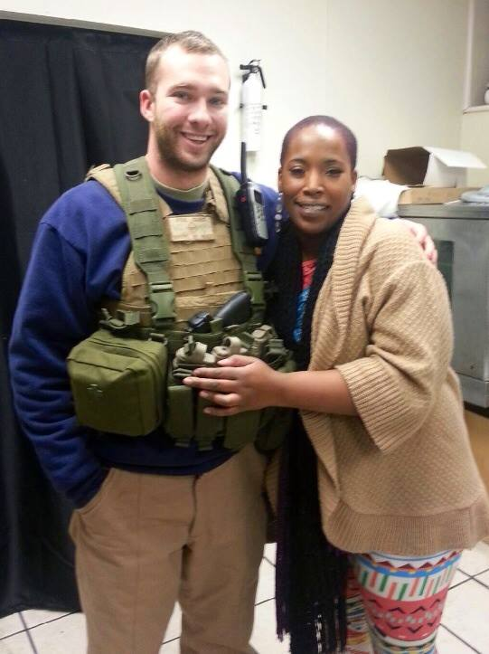 Ferguson and African American Woman protected by Oath Keepers