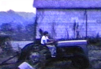 Farm Tractor and the two cousins in video.